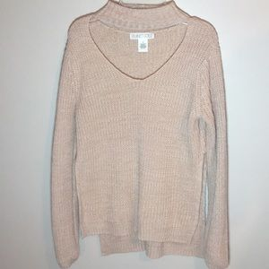 Light pink cut out V-neck sweater with side slits.